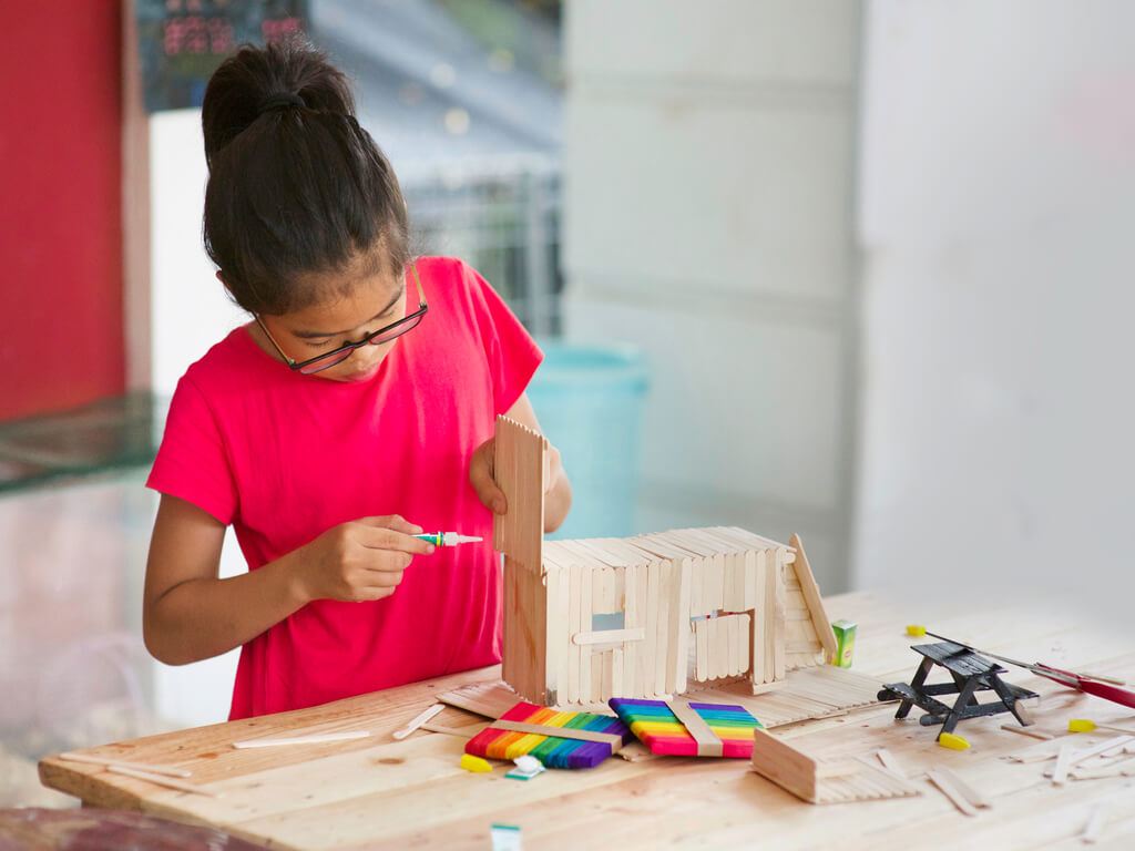 young girl doing math stem activities